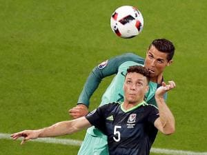 James Chester jumps for the ball with Cristiano Ronaldo at Euro 2016