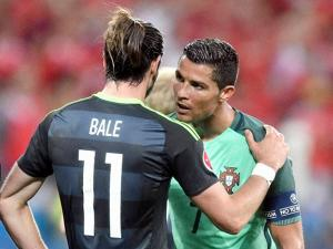 Wales' Gareth Bale talks with Portugal's Cristiano Ronaldo at the end of the Euro 2016