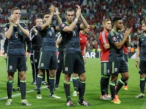 Wales's Gareth Bale, center, and teammates  acknowledge the fans at the end of  the Euro 2016