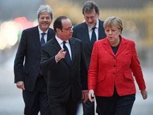 French President Francois Hollande leads with German Chancellor Angela Merkel Italian Prime Minister Paolo Gentiloni