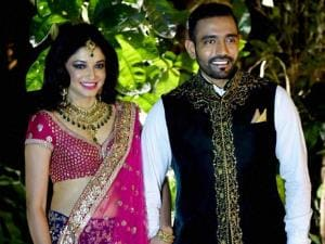 cricketer Robin Uthappa and his bride Sheetal Gautam before a reception in Bengaluru
