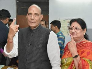 union home minister rajnath singh with wife showing their marked fingers with indelible ink