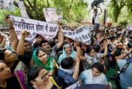 Contractual teachers shout slogans and display banners against Delhi CM Arvind Kejriwal