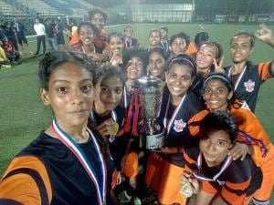 FC Pune City players pose for a selfie as they celebrate after winning WIFA Women's Championship 2017