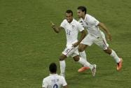 Julian Green celebrates scoring his side's first goal during the World Cup round of 16 soccer match