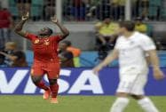 Romelu Lukaku celebrates after scoring his side's second goal in extra time during the World Cup round of 16 soccer match