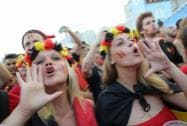 Belgium soccer fans cheer as they wait for the live telecast of the World Cup