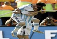 Argentina's Angel di Maria, right, and Lionel Messi celebrate after di Maria scored during the World Cup