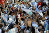 Argentina's fans celebrate after the World Cup round of 16 soccer match between Argentina and Switzerland