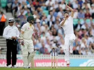 England's Mark Wood bowls to Australia's David Warner