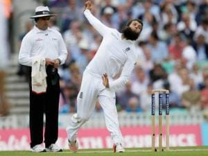 England's Moeen Ali bowls to Australia's Chris Rogers