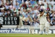 India's MS Dhoni hits two runs off the bowling of England's Stuart Broad