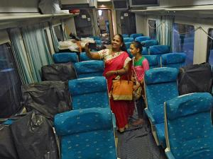A woman clicking selfie with daughter in Spanish train Talgo