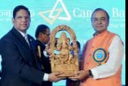 Union Finance Minister Arun Jaitley receives a memento from Chairman and MD, Canara Bank and RK Dubey