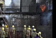 Firefighters try to contain a fire that broke out in a market in the Chandni Chowk area