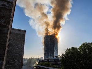Smoke billows from a high-rise apartment building in west London