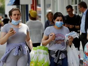Women wearing masks to protect from the smoke