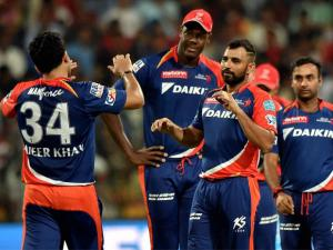 Delhi Daredevils bowler Mohammad Shammi  with teammates celebrate the wicket of  Virat Kohli during Indian Premier League (IPL) 2016 T20 match against Royal Challengers Bangalore in Bengaluru.