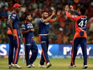 Delhi Daredevils bowler Mohammad Shammi _with teammates celebrate the wicket of  Virat Kohli during Indian Premier League (IPL) 2016 T20 match against Royal Challengers Bangalore in Bengaluru