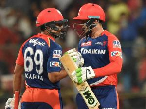 Delhi Daredevils Quinton De Cock and Karun Nair against Royal Challengers Bangalore during Indian Premier League (IPL) 2016 T20 match.
