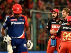 Royal Challengers Bangalore bowler Shane Watson with Virat Kohli celebrate the wicket of Sanju Samson of Delhi Daredevils during Indian Premier League (IPL) 2016 T20 match