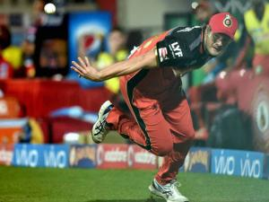 Royal Challengers Bangalore Shane Watson throws back the ball  after he catched it for the wicket of Shreyas Iyer of Delhi Daredevils during Indian Premier League (IPL) 2016 T20