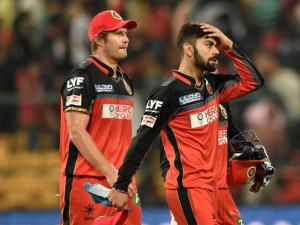 Royal Challengers Bangalore Skipper Virat Kohli and Shane Watson returns the pavilion after they lost against Delhi Daredevils during Indian Premier League (IPL) 2016 T20