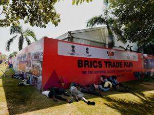 Workers rest at the venue of the first ever BRICS Trade Fair at Pragati Maidan