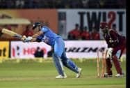 India's MS Dhoni is bowled out by West Indies' Darren Sammy during their first ODI match