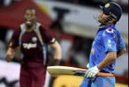 India's MS Dhoni reacting after he is bowled out by West Indies' Darren Sammy