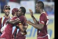 West Indies cricketer Jerome Taylor celebrating along with teammates for the wicket of India's Virat Kohli