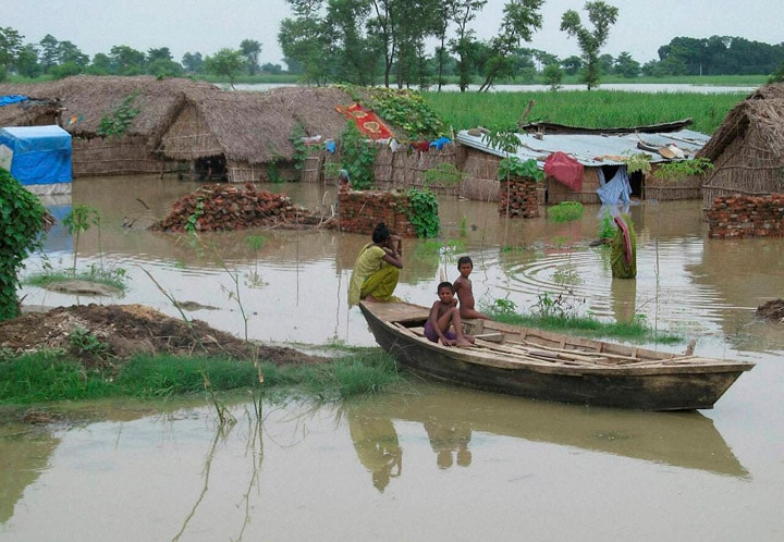 Children, boat, flood, affected, village, Dhaurehra, Tehsil, Lakhimpur, Kheeri