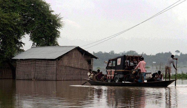 Villagers, carry, auto rickshaw, boat, safer, areas, flood, affected, Balimukh village, Morigaon district
