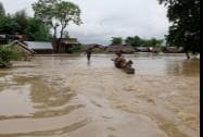 A view of a flooded road in Tikonia area near Indo-Nepal border in Lakhimpur Kheeri