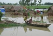 Children in a boat at a flood affected village in Dhaurehra Tehsil in Lakhimpur Kheeri