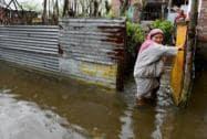 A woman moves towards a safer place at flood-hit Rainawari area of Srinagar