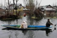 People move towards safer place on boat at flood-hit Rainawari in Srinagar