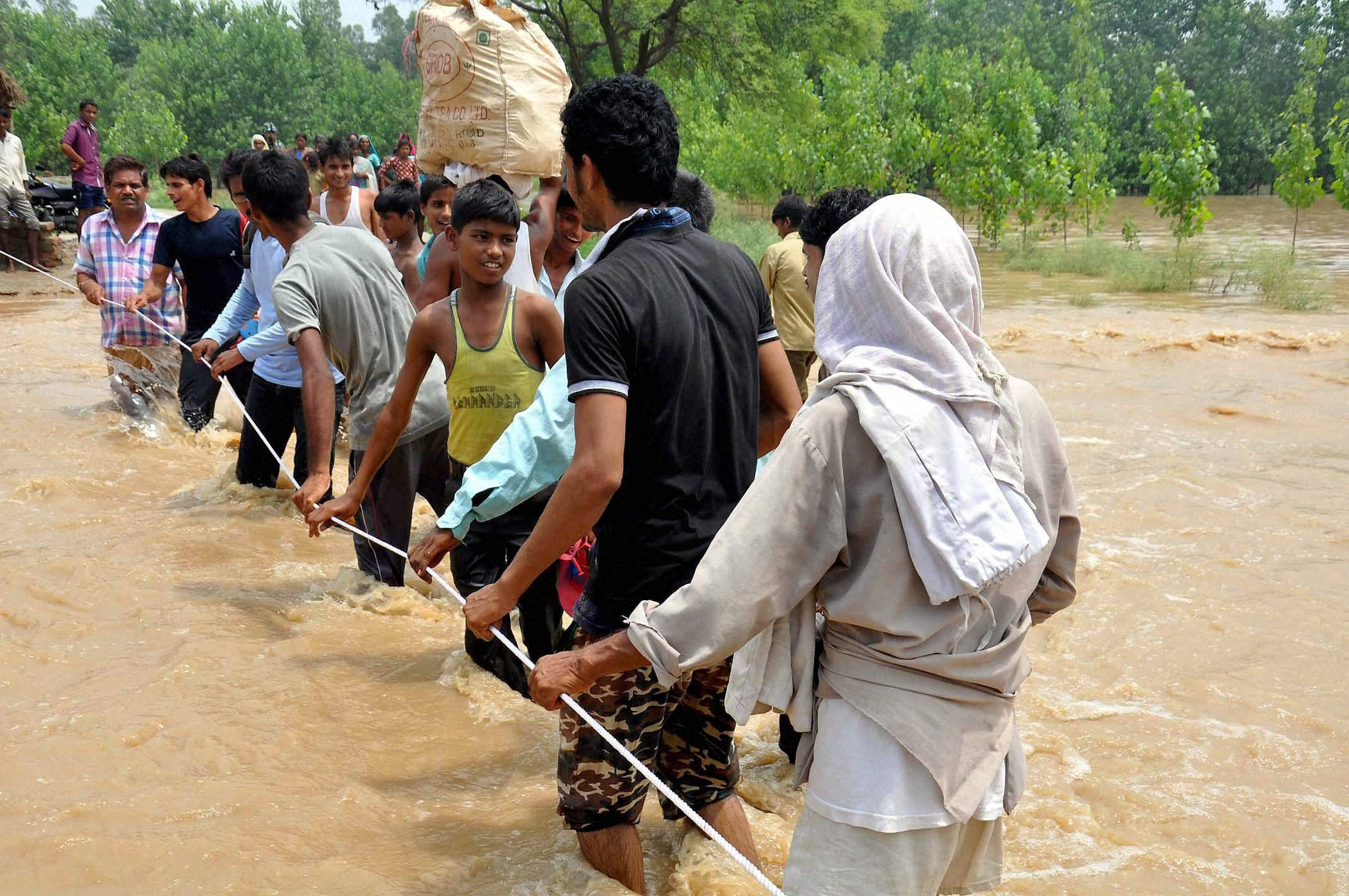 People, shifting, safe places, flooded, village, Moradabad district