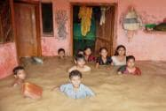 Children in a locality flooded by Ramganga River in Moradabad district