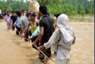 People shifting to safe places from a flooded  village in Moradabad district