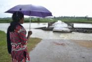 A girl looking at the damaged Gamarkunda bridge