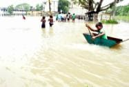 People in a flooded village in Murshidabad