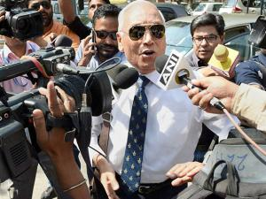 Former Air Chief Marshal S.P. Tyagi arriving at the CBI headquarters in New Delhi on Monday,in connection with alleged corruption in the 3,600 crore AgustaWestland choppers deal05