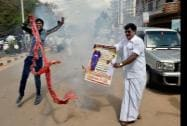 Former Tamil Nadu Chief Minister J Jayalalitha's supporters celebrate after she was granted bail