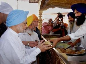 Manmohan Singh receiving 'parsad' at the Golden temple in Amritsar