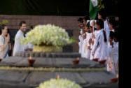 Congress President Sonia Gandhi and party Vice President Rahul Gandhi greet children