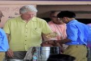 Former US President Bill Clinton serves food to students at 'Akshaya Patra' kitchen in Jaipur