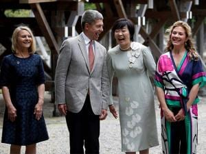 Partners of the G-7 summit participants exhange smiles as they pose for a photograph next to the Ujibashi bridge during a visit to the Ise Jingu shrine in Ise, Mie prefecture, Japan