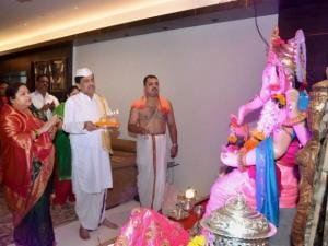 Ashok Chavan with wife  worshiping during the Ganpati festival