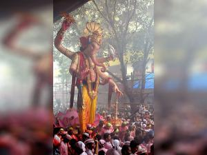 Devotees carry an idol of Lord Ganesh to Girgaon Chawpatty